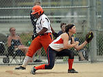 SIOUX FALLS, SD - JULY 7:  Amirah Michaeli #16 from the South Dakota Flash tries to beat the ball to first as Carolyn Osdoba #22 from the Mankato Peppers catches the ball for an out in the sixth inning of their 2013 Ringneck Softball tournament semi-final game Sunday evening at Sherman Park. (Photo by Dave Eggen/Inertia)