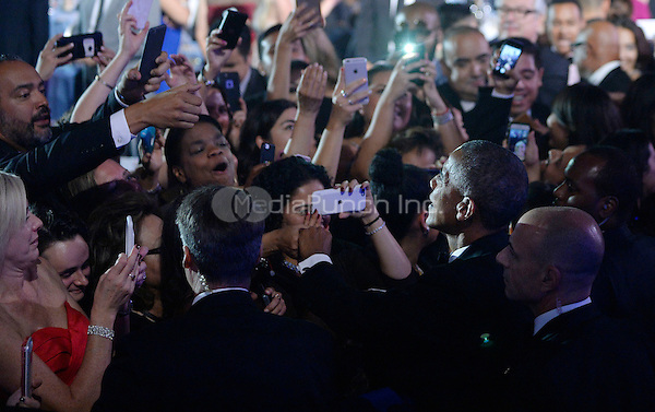 United States President Barack Obama checks hands with guests during the 39th Annual Congressional Hispanic Caucus Institute Public Policy Conference and Annual Awards Gala at the Walter E. Washington Convention Center September 15 2016, in Washington, DC. <br /> Credit: Olivier Douliery / Pool via CNP /MediaPunch