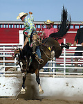 Chad Smith competing in the saddle bronc event at the Southeast Weld County CPRA Rodeo in Kennesburg, Colorao on August 12, 2006.