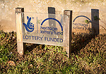 Sign in front of wall showing funding from Heritage National Lottery Fund, Suffolk, England, UK