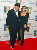Mix Master Mike and Diane Copeland arrive for the formal Artist's Dinner honoring the recipients of the 2013 Kennedy Center Honors hosted by United States Secretary of State John F. Kerry at the U.S. Department of State in Washington, D.C. on Saturday, December 7, 2013. The 2013 honorees are: opera singer Martina Arroyo; pianist,  keyboardist, bandleader and composer Herbie Hancock; pianist, singer and songwriter Billy Joel; actress Shirley MacLaine; and musician and songwriter Carlos Santana.<br /> Credit: Ron Sachs / CNP