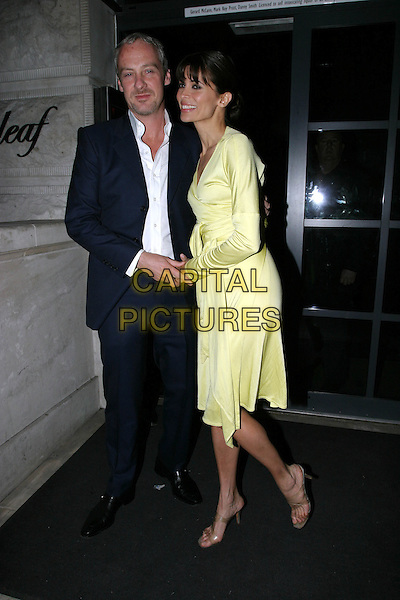 """ANTON & LISA B.Leaving after party for film """"The Day After Tomorrow"""", London,.26th May 2004..full length full-length yellow wraparound dress.www.capitalpictures.com.sales@capitalpictures.com.©Capital Pictures"""