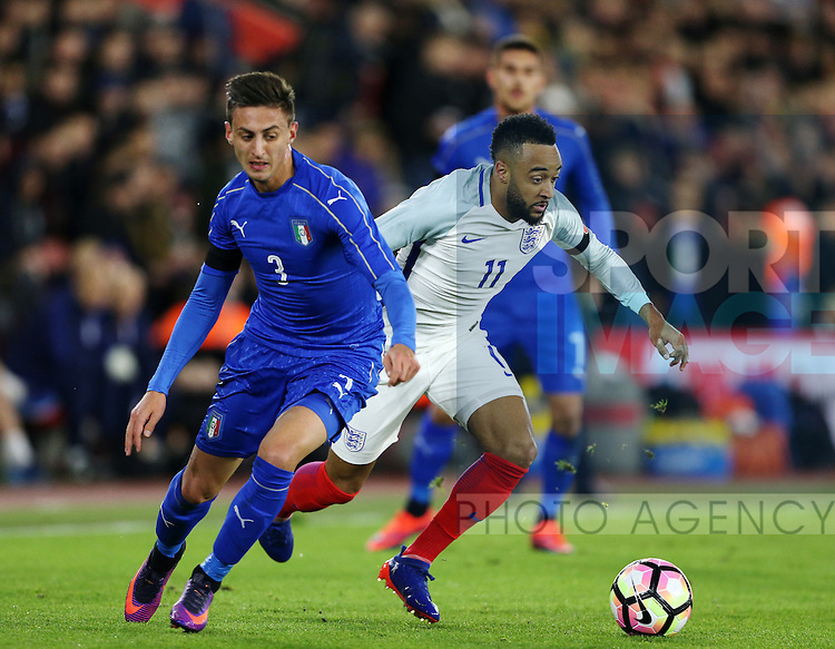 England's Nathan Redmond tussles with Italy's Antonio Barreca during the Under 21 International Friendly match at the St Mary's Stadium, Southampton. Picture date November 10th, 2016 Pic David Klein/Sportimage