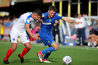 Ben Purrington of AFC Wimbledon tries to shake off a challenge from Portsmouth's Gareth Evans during AFC Wimbledon vs Portsmouth, Sky Bet EFL League 1 Football at the Cherry Red Records Stadium on 13th October 2018