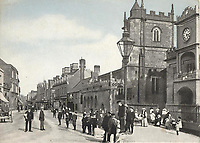 BNPS.co.uk (01202 558833)<br /> Pic: ShaftesburyHistoricalSociety/BNPS<br /> <br /> Pictured: St Peter's Church (right) on the high street pictured in 1902. Claire Ryley, of the Shaftesbury and District Historical Societ said, 'It is fascinating to see how the high street looked at a time when people took precedence over cars' <br /> <br /> These charming photos reveal everyday life at the turn of the 20th century in a thriving market town later made famous by a TV advert.<br /> <br /> The black and white snapshots of Shaftesbury, Dorset, were taken by Albert Tyler who set up a photography business there in 1901.<br /> <br /> There are various street scenes and also images of the locals in traditional attire, with men in flatcaps and women in bonnets.<br /> <br /> Tyler photographed the busy opening of the town market in 1902, and a garden party where men played croquet.