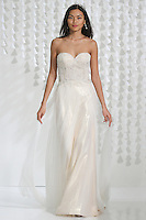 Model walks runway in a wedding dress from the Love Marley 2015 collection, by Vatana Watters for the Watters Fall 2015 fashion show, at The Knot Couture Show, during New York Bridal Fashion Week.