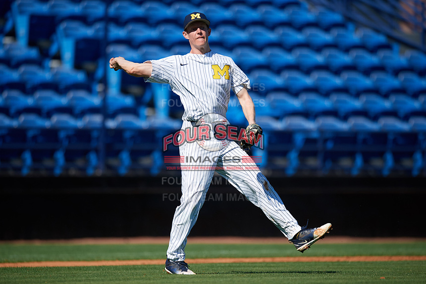 Michigan Wolverines third baseman Jimmy Kerr (15) throws to first base during a game against Army West Point on February 18, 2018 at Tradition Field in St. Lucie, Florida.  Michigan defeated Army 7-3.  (Mike Janes/Four Seam Images)