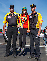 Aug 21, 2016; Brainerd, MN, USA; NHRA pro stock motorcycle rider Angelle Sampey with NHRA officials during the Lucas Oil Nationals at Brainerd International Raceway. Mandatory Credit: Mark J. Rebilas-USA TODAY Sports