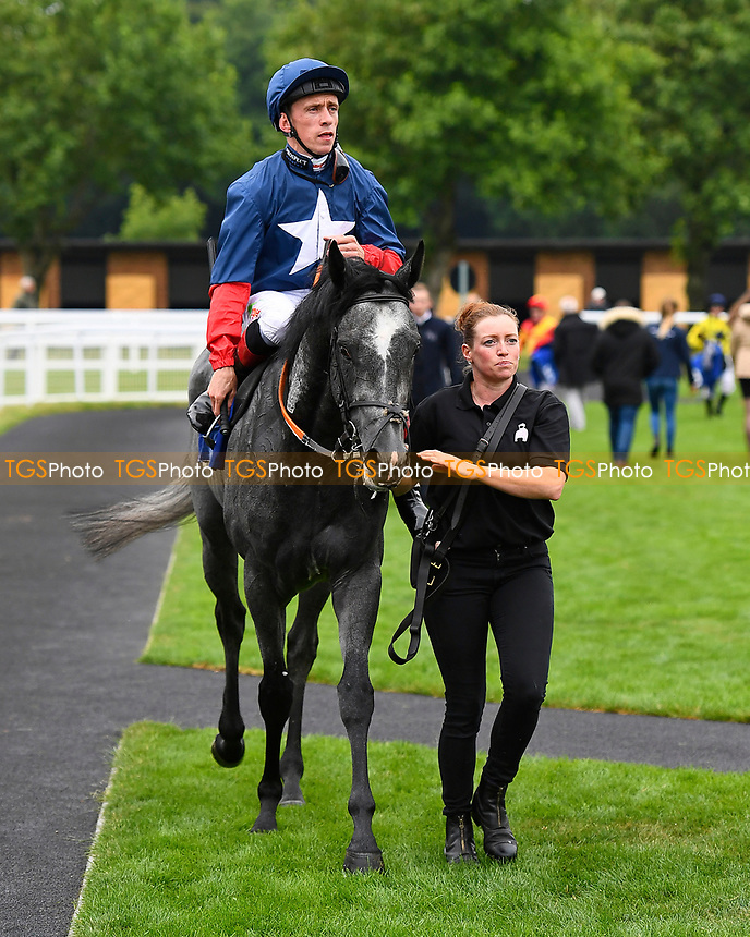 See of Rome ridden by Shane Kelly is led into the winners enclosure  after winning Winner of The British EBFf Venture Security Maiden Stakes, during Whitsbury Manor Stud Bibury Cup Day Racing at Salisbury Racecourse on 28th June 2017