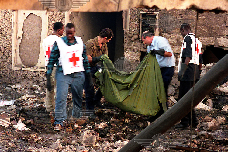 Kenya Red Cross volunteers and officials from the Israeli embassy helping to retrieve bodies from the smouldering rubble a couple of hours after the bomb blast at the Paradise Hotel..13 people were killed when a car bomb exploded outside the Israeli-owned hotel, at the same time as a failed rocket attack on an Israeli airliner taking off from Mombasa. A statement from al Qaeda claimed responsibility.