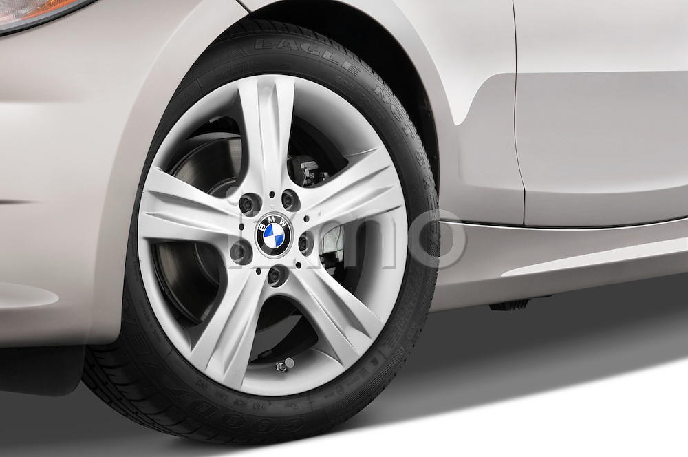 Tire and wheel close up detail view of a 2007 - 2011 BMW 1-Series 128i convertible.