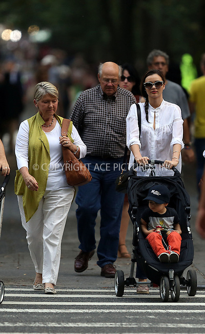 WWW.ACEPIXS.COM<br /> <br /> September 12 2013, New York City<br /> <br /> Model Miranda Kerr takes her son Flynn Bloom to a playground in Central Park on September 12 2013 in New York City<br /> <br /> By Line: Philip Vaughan/ACE Pictures<br /> <br /> ACE Pictures, Inc.<br /> tel: 646 769 0430<br /> Email: info@acepixs.com<br /> www.acepixs.com