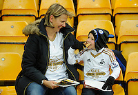 Swansea City fans enjoying a bite to eat during the Barclays Premier League match between Norwich City and Swansea City played at Carrow Road, Norwich on November 6th 2015