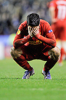 21.02.2013 Liverpool, England. Luis Suarez  of Liverpoo distraught on his haunches after the final whistle  in the Europa League game between Liverpool and Zenit St Petersburg from Anfield. Liverpool won 3-1 on the night but went out of the competition on away goals.