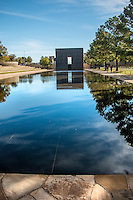 The Oklahoma City National Memorial.<br /> <br /> The outdoor symbolic memorial is a place of quiet reflection, honoring victims, survivors, rescuers and all who were changed forever on April 19, 1995. It encompasses the now sacred soil where the Alfred P. Murrah Federal Building once stood, capturing and preserving forever the place and events that changed the world.<br /> <br /> The Reflecting Pool sits <br /> Between the Gates of Time.  The pool reflects all that has changed as a result of the attack; symbolically it represents the limitless impact of the event. Our own reflection in the pool leads us to contemplate how different the world we live in today is from that of 1995. The pool sits where NW 5th Street once ran. McVeigh drove down NW 5th Street to access the Alfred P. Murrah Federal Building and parallel parked the Ryder truck containing the explosives on the north side of the building. In respect for those lives lost, NW 5th Street, between Robinson and Harvey, was closed forever.