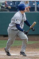 August 7, 2007: Catcher Lars Davis of the Tri-City Dust Devils exits the batter's box during a Northwest League game against the Everett AquaSox at Everett Memorial Stadium in Everett, Washington.