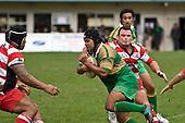 Karaka prop Paul Wymer manages to grab Tisa Fakaufo as he goes past. Counties Manukau Premier Club Rugby game between Drury & Karaka played at the Drury Domain on Saturday April 26th, 2008..Karak won the game 30 -6 after leading 8 -3 at halftime.