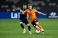 29th July 2020; Bankwest Stadium, Parramatta, New South Wales, Australia; A League Football, Melbourne Victory versus Brisbane Roar; Corey Brown of Brisbane Roar under pressure from Storm Roux of Melbourne Victory