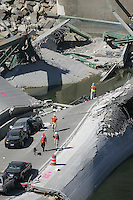 Minneapolis, Minn.- Search and recovery teams with recovery dogs working to locate survivals, or bodies, in the area of collapse of the Interstate 35W  freeway bridge in Minneapolis, Thursday, Aug. 2, 2007.