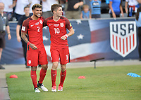 Commerce City, CO - Thursday June 08, 2017: DeAndre Yedlin, Christian Pulisic and Michael Bradley celebrate a goal during their 2018 FIFA World Cup Qualifying Final Round match versus Trinidad & Tobago at Dick's Sporting Goods Park.