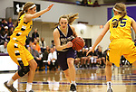 SIOUX FALLS, SD - DECEMBER 31: Lauren Sanders #32 from the University of Sioux Falls drives between a pair of defenders including Presley O'Farrell #35 from Augustana University during their game Sunday afternoon December 31, 2017 at the Stewart Center in Sioux Falls. (Photo by Dave Eggen/Inertia)