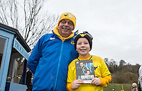 Oxford supporters hold a match day programme during the Sky Bet League 2 match between Wycombe Wanderers and Oxford United at Adams Park, High Wycombe, England on 19 December 2015. Photo by Andy Rowland.