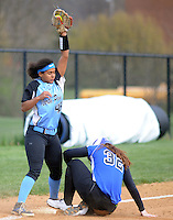 North Penn's Courtney Neal #48 receives the ball too late to tag out Quakertown's Lauren Beal #32 at third base in the fourth inning Monday, April 11, 2016 at North Penn High School in Towamencin, Pennsylvania. North Penn defeated Quakertown 4-1. (Photo by William Thomas Cain)