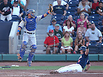 Reno Aces' Mike Jacobs slides safely under Las Vegas 51s catcher Juan Centeno during a Triple-A baseball game in Reno, Nev., on Sunday, July 21, 2013. The 51s won 15-8.<br /> Photo by Cathleen Allison