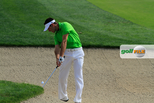 Charl Schwartzel plays his 2nd shot from a fairway bunker on the 8th hole during Day 3 Saturday of the Abu Dhabi HSBC Golf Championship, 22nd January 2011..(Picture Eoin Clarke/www.golffile.ie)