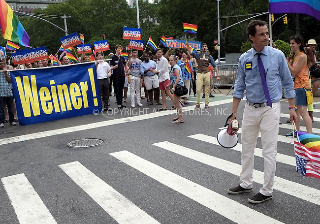 WWW.ACEPIXS.COM<br /> <br /> April 30 2013, New York City<br /> <br /> Anthony Weiner at The March during NYC Pride 2013 on June 30, 2013 in New York City.<br /> <br /> <br /> By Line: Curtis Means/ACE Pictures<br /> <br /> <br /> ACE Pictures, Inc.<br /> tel: 646 769 0430<br /> Email: info@acepixs.com<br /> www.acepixs.com