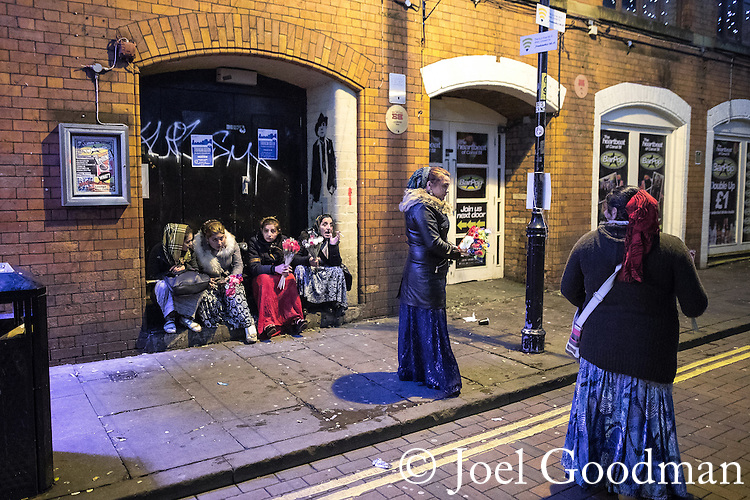"© Joel Goodman - 07973 332324 . 16/12/2016 . Manchester , UK . Street flower sellers on Canal Street in Manchester's Gay Village . Revellers out in Manchester City Centre overnight during "" Mad Friday "" , named for being one of the busiest nights of the year for the emergency services in the UK . Photo credit : Joel Goodman"