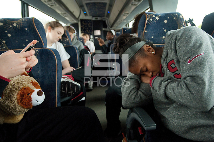 STANFORD, CA--Erica Payne has a chat on her mobile device on the bus to the airport en route to Norfolk, VA for the first and second rounds of the 2012 NCAA tournament.