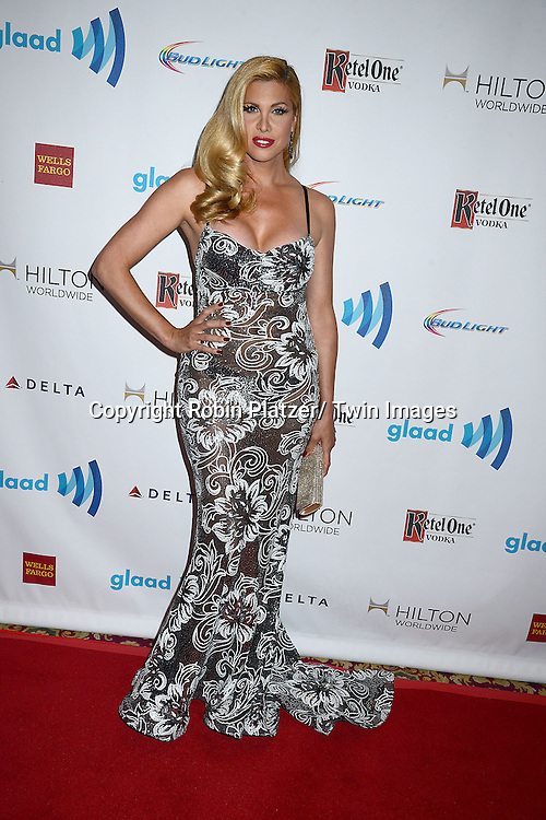 Candis Cayne attends the 25th Annual GLAAD Media Awards at the Waldorf Astoria Hotel in New York City, NY on May 3, 2014.
