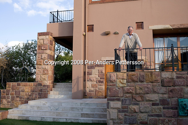 JOHANNESBURG, SOUTH AFRICA - JUNE 9:  Laurie Dippenaar, the former CEO of FirstRand stands on a terrace outside his house on June 9, 2008 in Bryanstown outside Johannesburg, South Africa. Mr. Dippenaar started out with about $US 10.000 in 1977 and he is now one of the South Africa?s wealthiest men. He started FirstRand group, one of the largest financial institutions in the country. (Photo by: Per-Anders Pettersson/Getty Images)...