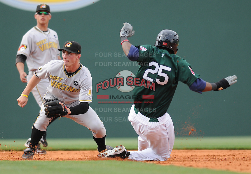 Michael Almanzar (25) of the Greenville Drive is tagged out at second by West Virginia Power second baseman Jarek Cunningham (7) in a game against the Greenville Drive in a game on May 2, 2010, at Fluor Field at the West End in Greenville, S.C. Photo by: Tom Priddy/Four Seam Images