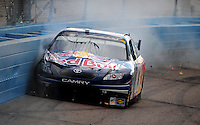 Nov. 9, 2008; Avondale, AZ, USA; NASCAR Sprint Cup Series driver Brian Vickers hits the wall during the Checker Auto Parts 500 at Phoenix International Raceway. Mandatory Credit: Mark J. Rebilas-