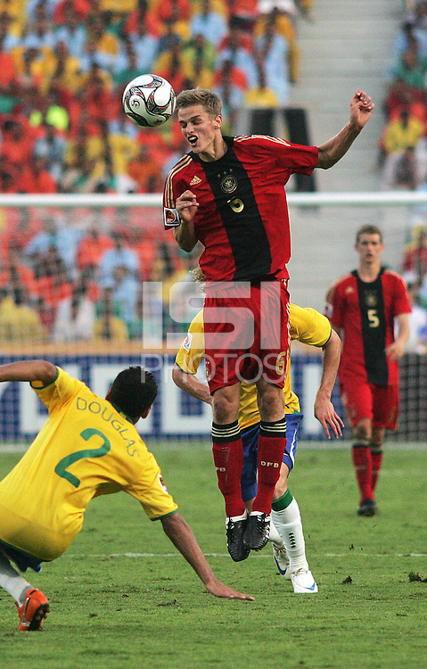 Germany's Sven Bender (6) sends a header over Brazil's Douglas (2) during the FIFA Under 20 World Cup Quarter-final match at the Cairo International Stadium in Cairo, Egypt, on October 10, 2009. Germany lost 2-1 in overtime play.