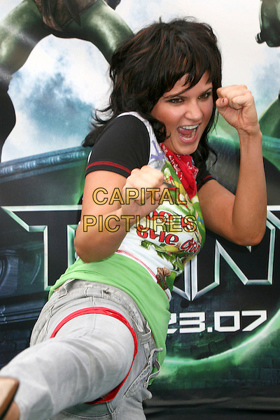 "LIZZY STRAIN .""TMNT"" (aka. ""Teenage Mutant Ninja Turtles"") Los Angeles Premiere at Grauman's Chinese Theatre, Hollywood, California, USA, 17 March 2007..half length funny kicking pose hands arms .CAP/ADM/BP.©Byron Purvis/AdMedia/Capital Pictures."