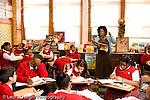 K-8 Parochial School Bronx New York Grade 5 female teacher talking to group social studies horizontal