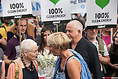 Vivienne Westwood talks to Emma Thompson with Peter Gabriel behind at the Climate Change demonstration, London, 21st September 2014. © Sue Cunningham
