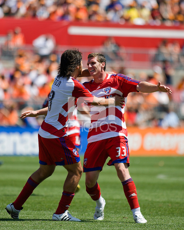FC Dallas midfielder Juan Toja (8) and FC Dallas forward Kenny Cooper (33) celebrate Cooper's 35th minute goal.  The Houston Dynamo tied  FC Dallas 3-3 at Robertson Stadium in Houston, TX on April 6, 2008.