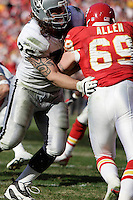 Oakland Raiders tackle Robert Gallery blocks Jared Allen at Arrowhead Stadium in Kansas City, Missouri on November 19, 2006. The Chiefs won 17-13.