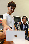 First buyer Mr. Shimizu buys and Apple's new iPhone XS Max at the Apple Store in Omotesando on September 21, 2018, Tokyo, Japan. Apple fans lined up patiently in the early morning rain to get the new iPhone models (XS and XS Max) and the new iWatch (Series 4). The new iPhone XS costs JPY 112,800 for the 64 GB model, the iPhone XS Max costs JPY 124,800 JPY for the 64 GB model, and iWatch Series 4 costs JPY 45,800. (Photo by Rodrigo Reyes Marin/AFLO)