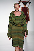 Model walks runway in an outfit from the Pastoral Existence collection by Stephanie Chudy, during the Pratt 2011 fashion show.
