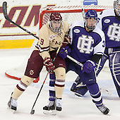 Brendan Silk (BC - 9), Logan Smith (HC - 33) - The visiting College of the Holy Cross Crusaders defeated the Boston College Eagles 5-4 on Friday, November 29, 2013, at Kelley Rink in Conte Forum in Chestnut Hill, Massachusetts.