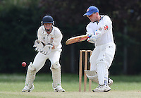 P French in batting action for Noak Hill as M Gooch looks on from behind the stumps - Hornchurch Athletic CC 3rd XI vs Noak Hill Taverners CC - Lords International Essex Cricket League at Hylands Park - 27/06/09- MANDATORY CREDIT: Gavin Ellis/TGSPHOTO - Self billing applies where appropriate - 0845 094 6026 - contact@tgsphoto.co.uk - NO UNPAID USE.
