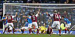 Michael Travis almost scores a third for Arbroath but Fraser Aird blocks