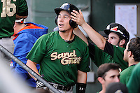 Third baseman Eudor Garcia (28) of the Savannah Sand Gnats, is congratulated after scoring a run in a game against the Greenville Drive on Sunday, July 5, 2015, at Fluor Field at the West End in Greenville, South Carolina. Savannah won, 8-6. (Tom Priddy/Four Seam Images)