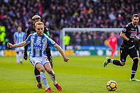Huddersfield Town's midfielder Alex Pritchard (21) squares the ball during the EPL - Premier League match between Huddersfield Town and Crystal Palace at the John Smith's Stadium, Huddersfield, England on 17 March 2018. Photo by Stephen Buckley / PRiME Media Images.