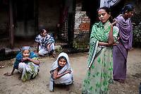"(L-R: (blue) Saraswati Saha, 84; unnamed; (white) Kamla Das, 90; (green) Purnima Mandol, 36; and unnamed) Elderly women who were the original refugees of The Partition gather and discuss their unfortunate situation outside their homes in Cooper's Camp, Nadia district, Ranaghat, North 24 Parganas, West Bengal, India, on 19th January, 2012. ""They dropped us off here (over six decades ago) and I'm still here!"" says Kamla Das. ""We would never want to go back to Bangladesh."" Over 60 years after the bloody creation of Bangladesh in 1947, refugees who fled what was then known as West Pakistan to India still live as refugees, standing in line for government handouts..Photo by Suzanne Lee for The National (online byline: Photo by Szu for The National)"